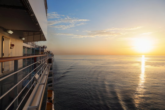 morning view from deck of cruise ship. sunset above water