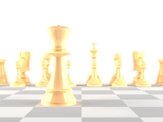 The queen chess piece in focus