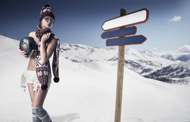 Cute woman in mountains wearing scarf