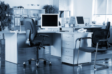 Office interior with blue tint