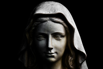 Holy Mary statue isolated on black