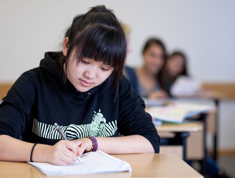 Student working on homework in classroom