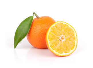fresh mandarin fruits with cut and green leaves