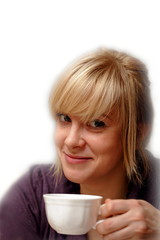 Young attractive blond woman with cup of coffee