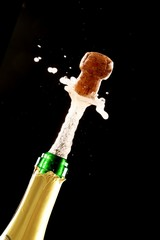 Cork Shooting Out Champagne Bottle