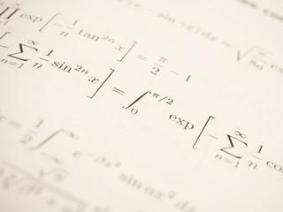 Advanced mathematical formulas in a book.