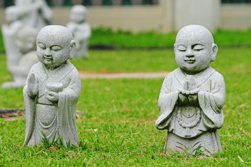 Young Buddha Statues At A Temple Compound