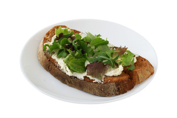 bread with cream cheese and salad on a plate