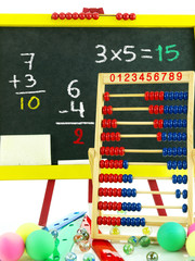 Colorful chalkboard with abacus and marbles