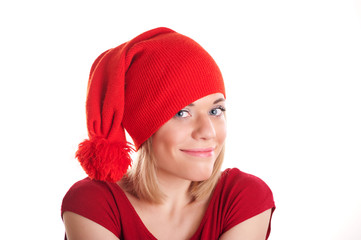 smiling girl in a red cap with a white background