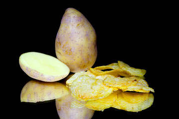 Potato and chips isolated on black background