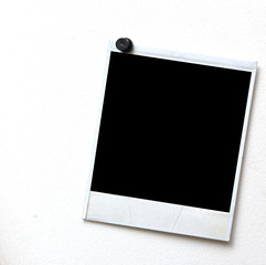 photo frame pressed the black pushpin to the background