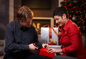Young couple wrapping christmas presents