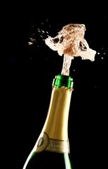 Cork Exploding Out Champagne Bottle
