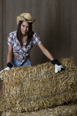 Cowgirl and bales