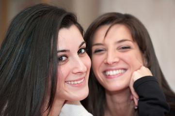 Two Smiling Teen Girls