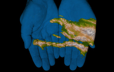 Painted Map Of Haiti on Hands Representing Haiti is in Our Hands