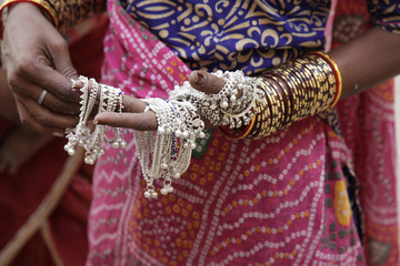 indian woman showing traditional jewelry.