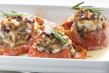 baked tomatoes with chicken meat and mushrooms