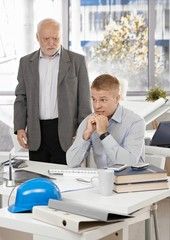 Scared office worker with angry executive
