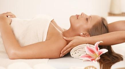 Young woman enjoying neck massage