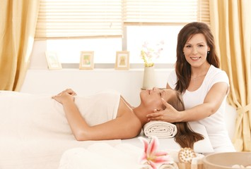 Young attractive woman getting beauty treatment