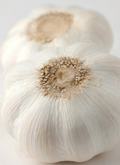 Two heads of garlic, vertical shot, selective focus
