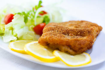 Schnitzel on lemon slices