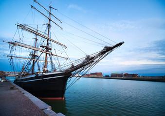 Sailing vessel in port