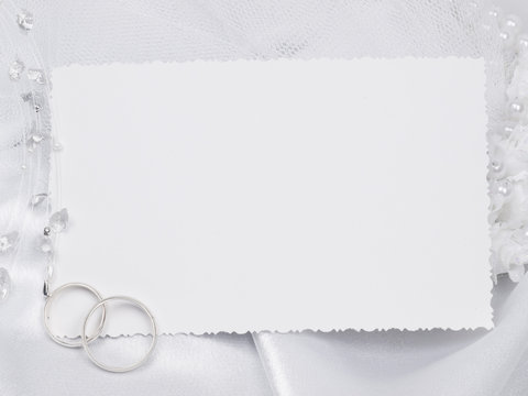 Silver wedding rings on a card
