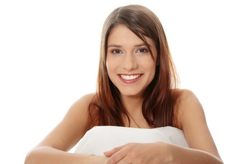 Beautiful young happy caucasian woman in bed