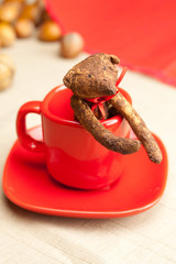 Teddy bear handmade in a cup and nuts