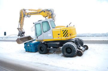 excavator in snow