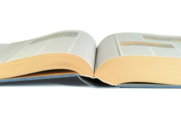 Close-up of a luxury bound open book isolated on white