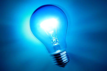 alight bulb over blue background