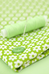 Sewing Items on Floral Cloth