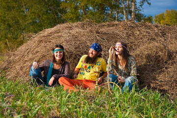 group of hippies sitting on the grass