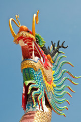 Head shot of colorful dragon statue with blue sky