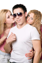 Portrait of a two attractive blonde women with young man