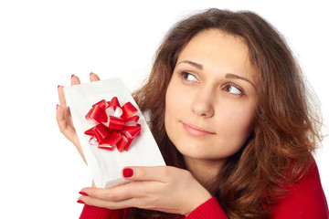 Pretty girl holding a gift. Isolated on white