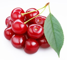 Group ripe cherries with a leaf on a white background.