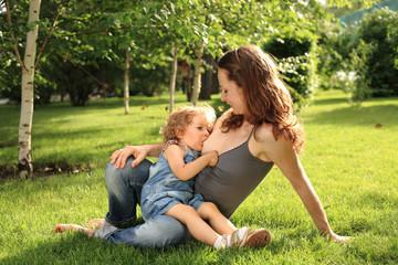 Cute child breastfeeding