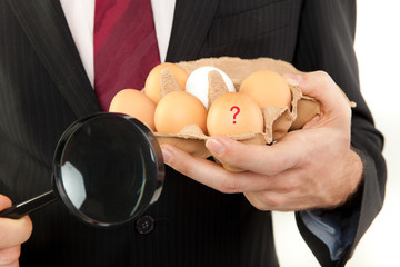 businessman with egg in the hands