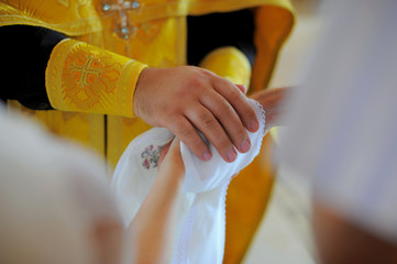 Pastor blesses the bridal couple. Close-up on the hands.