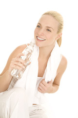 Woman with towel on her back drinking
