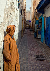 unrecognizable man and old arabic street