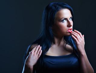 Beautiful young woman, dark portrait