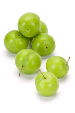 green plums on white