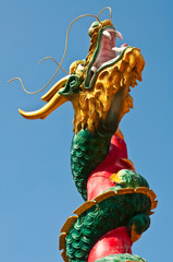 Dragon statue with column on blue screen
