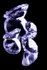 Crystal gemstones on black mirror